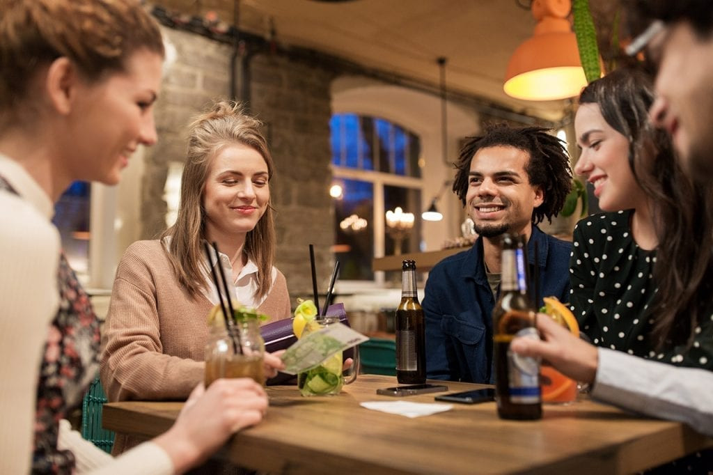 Group of Friends Enjoying a Drink in a profitable bar